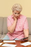 Woman is upset and afflicted her debts Stock Photos