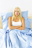 Woman upset in bed Stock Image