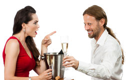 Woman upset with flirting boyfriend Royalty Free Stock Photo