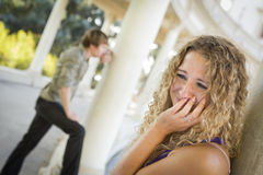 Woman Upset While Man Comtemplates in the Background Stock Images