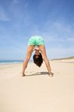 Woman upside down at beach Stock Image