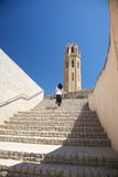 Woman upstairs to cathedral at Lleida city Royalty Free Stock Images