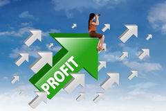 Woman with upward arrow and profit word Royalty Free Stock Photography