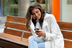 Woman in urban background talking on phone Royalty Free Stock Photography