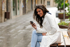 Woman in urban background talking on phone Stock Image