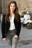 Woman in urban background wearing casual clothes Royalty Free Stock Images