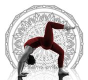 Woman In Urdhva Dhanurasana Yoga Pose on mandala background. Beautiful young woman working out in studio, doing yoga exercise on floor, stretching, standing in Stock Images