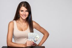 Woman with us dollar money. In hand over grey background, with copy space stock image
