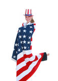 Woman in USA Flag. Pretty young woman celebrating fourth of July with hat and flag Stock Photo