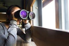 Woman use of the binocular Stock Photos