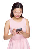 Woman use of the cellphone Stock Image