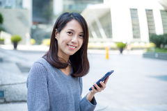 Woman use of cellphone at outdoor Stock Photography