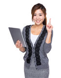 Woman use of digital tablet and finger point up Royalty Free Stock Photos