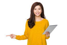 Woman use of the digital tablet and finger point up Stock Image