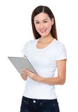Woman use of digital tablet Stock Image