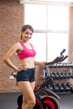 Woman use exercise bike Royalty Free Stock Photography