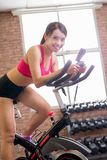 Woman use exercise bike Royalty Free Stock Photo