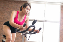 Woman use exercise bike. And training hard Stock Images
