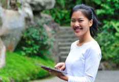 Woman use ipad at garden Stock Photo