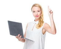 Woman use of laptop computer and thumb up Stock Image