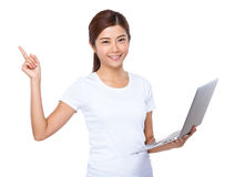 Woman use laptop and finger point up Royalty Free Stock Photo