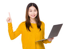 Woman use of laptop and finger point up Stock Photography
