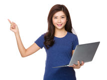 Woman use of laptop and finger point up Stock Photo