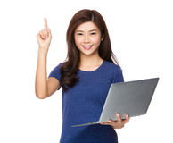 Woman use of laptop and finger point upwards Royalty Free Stock Photography