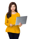 Woman use of laptop Stock Images