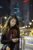 Woman use mobile phone in city Stock Photography