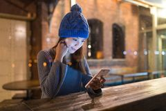 Woman use of mobile phone inside cafe Stock Photo