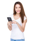 Woman use of mobile phone Royalty Free Stock Photos