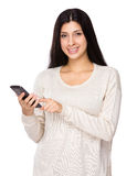 Woman use mobile phone Royalty Free Stock Photography