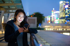 Woman use of mobile phone at night Royalty Free Stock Image