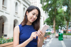 Woman use of mobile phone Stock Photo