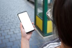 Woman use mobile phone with round edges on city streets Royalty Free Stock Photography