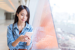 Woman use of mobile phone in shopping mall. Asian young woman Royalty Free Stock Images