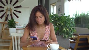 Woman use online banking. On smartphone stock video