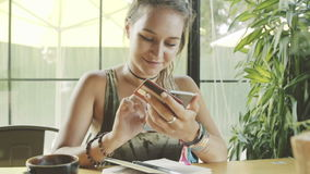 Woman use online banking with smartphone in cafe. stock video