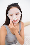 Woman use of the paper mask on bed Stock Photo