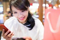 Woman use phone and card stock photos