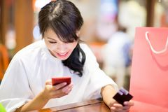 Woman use phone and card stock photo