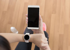 woman use phone fitness exercise in gym smart gadgets and sport stock photos