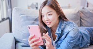 Woman use phone happily royalty free stock photos