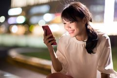 Woman use phone happily royalty free stock photo
