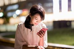 Woman use phone happily royalty free stock photography