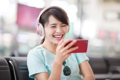 Woman use phone listen music royalty free stock photo