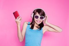 Woman use phone listen music Stock Photos