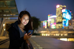 Woman use phone at outdoor Stock Image