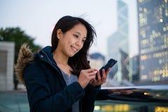 Woman use of smart phone. At Hong Kong royalty free stock photography